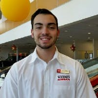Hugh Tomkins at Woodmen Nissan
