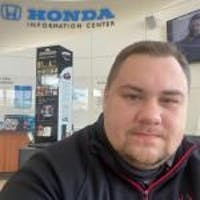 Sergey  Gnid at Luther Hopkins Honda